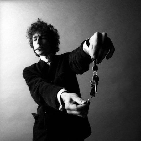 Bob Dylan Holding Lit Match Under Keys